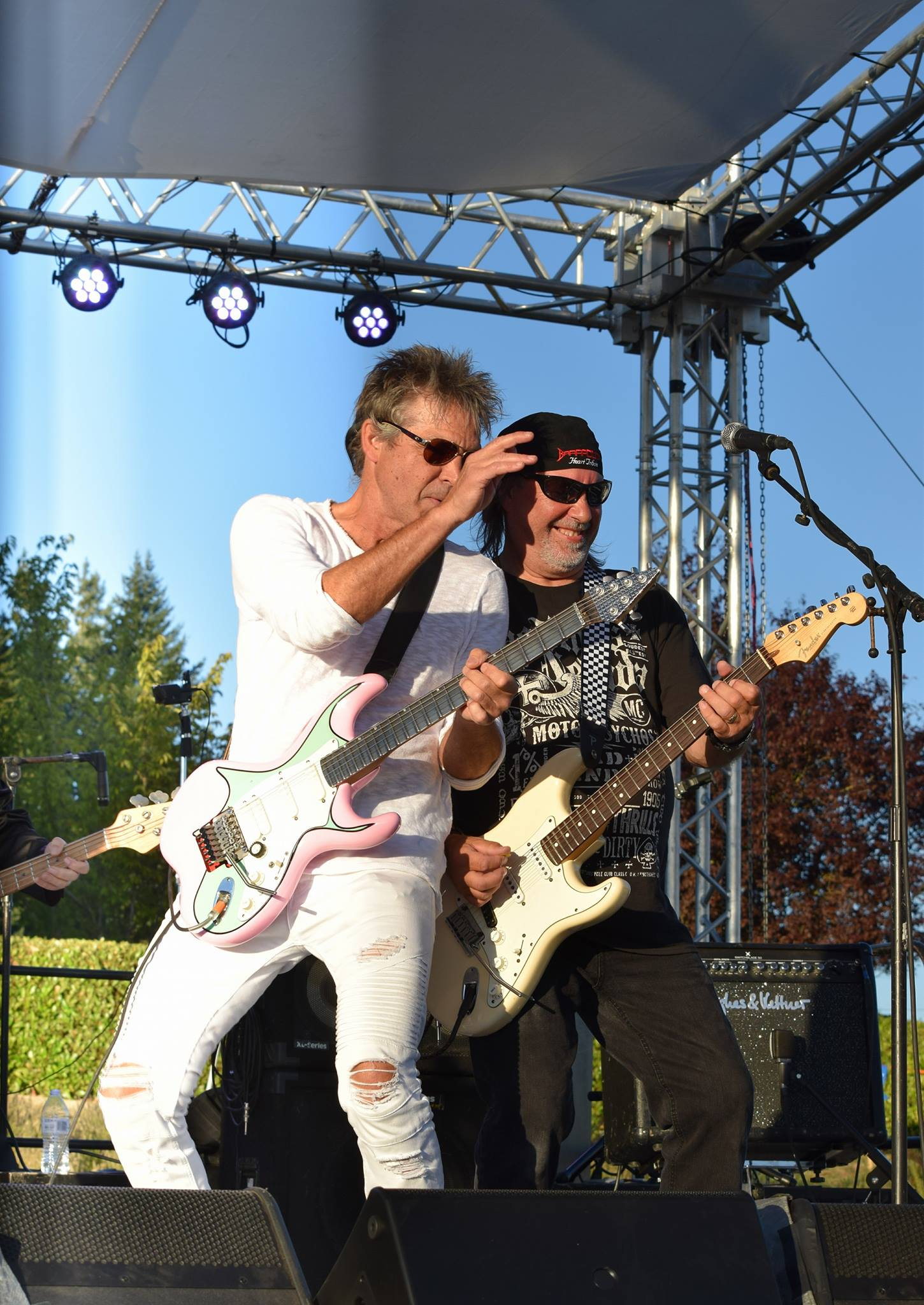 Two great Axemen - ROGER FISHER (co-founder Heart) & RAY ROPER (co-founder Stonebolt) shown here with BARRACUDA-The Essential Tribute to the band HEART at the 2017 VINEYARD JAM. Courtesy Murray Mcvay.